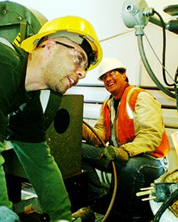 two workers laughing
